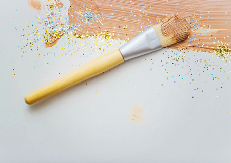 flaws: Flat brush for makeup, face cream, cream smears Stock Photo