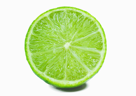 Juicy lime in a cut, close-up on a white background.