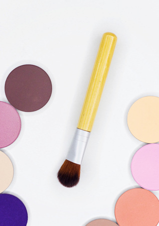 All for make-up. Fashionable brush for textures. Different eyeshadow on white.