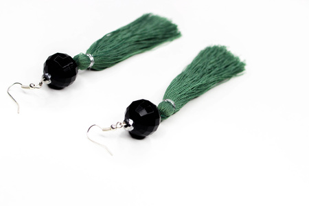 Beautiful hanging earrings of green color on a white background Banque d'images - 92345790