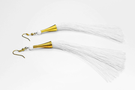 Beautiful white earrings crafted in gold on a white background.