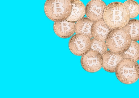 Bitcoin on a blue background, isolated gold coins. Stock Photo - 102254729