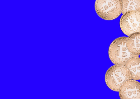 Bitcoin on a blue background, isolated gold coins.