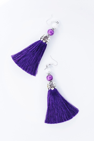 Sergi-tassels made of silk thread and jewelry on a white background. Handmade.
