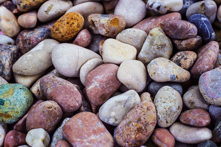 Many sea stones of different color and size. Smooth stone. Pebbles. Archivio Fotografico