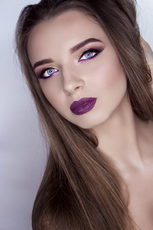 Professional make-up for a very beautiful blue-eyed model.