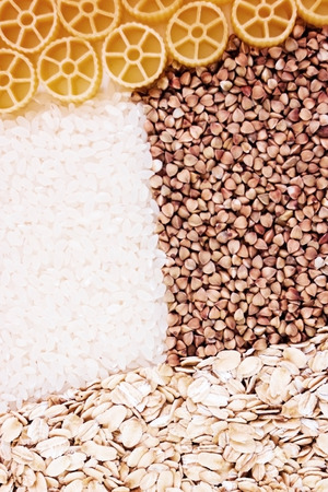 Dry foods of healthy nutrition, seeds of healthy foods, rice, buckwheat, pasta, pasta, dried products, background or texture