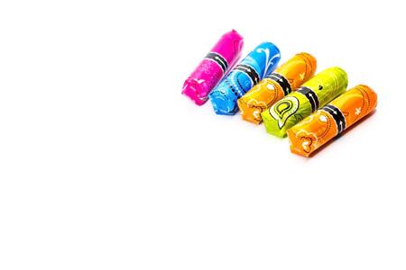 colorful tampons and white handbag on mint background Banco de Imagens