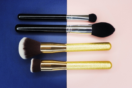 Makeup brushes and crushed eyeshadow