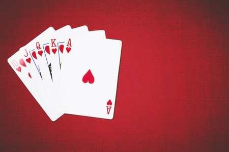 Poker Hands Royal Flush 3. Five playing cards - the poker royal flush hand. Royal Flash, card deck, poker royal flash on cards and poker chips on green casino table. success in gambling. soft focus