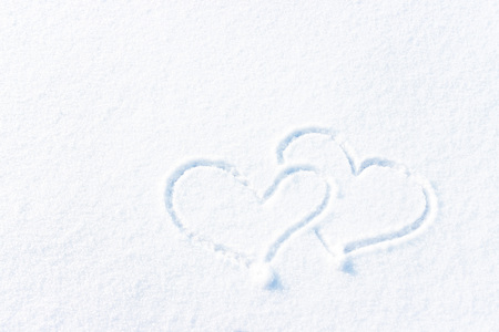 Love, the inscription on the snow, background or texture for love.