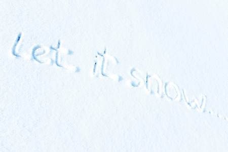Let it snow, the inscription on the snow Stock Photo