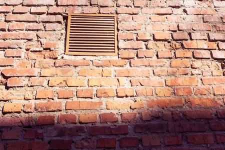 Lattice on a brick wall. Brick wall and old lattice