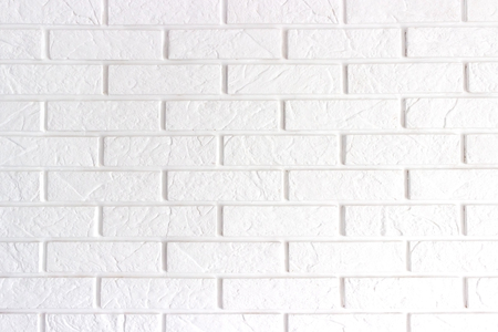 white brick background. Wall is made from bricks and painted with white color.