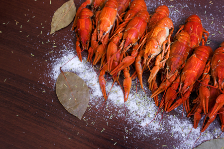 delicious crayfish on a wooden background. crayfish with peps on a gray wooden background. Imagens