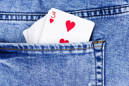 Playing cards, aces in jeans pocket close up. Standard-Bild