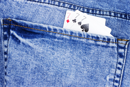 Playing cards for poker in jeans pocket