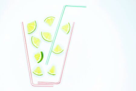 Lime in a glass of straws, Concept