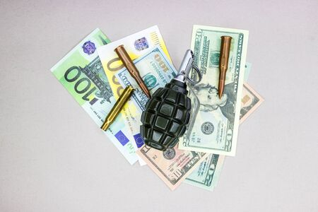 Hand grenade and money, background or texture for arms trade