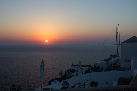 Sunset from the town of Oia in Santorini island. Stock Photo