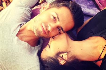 french kiss:  Woman give french kiss to her boyfriend . Closeup shot
