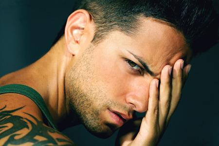 handsome man with headache