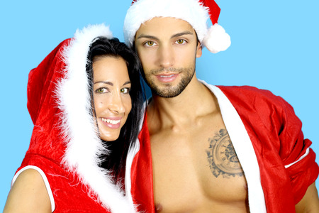 sexy santa claus: Young couple at Christmas Stock Photo