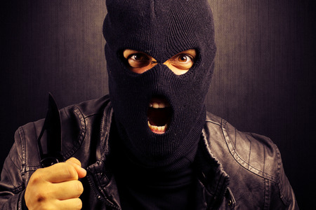 male killer: criminal who assaulted with a knife Stock Photo