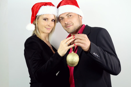 christmas ornamentation: couple showing two christmas balls