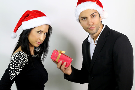 unhappy young couple for a gift for Christmas Stock Photo