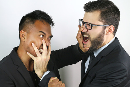strangle: two young businessmen fighting