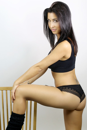 Sexy go go dancer posing on a chair Stock Photo