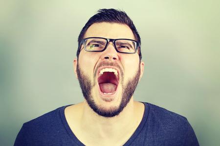 wrath: portrait of a businessman screaming