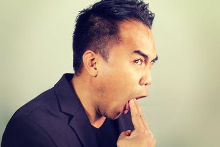 vomit: businessman who forces himself to vomit