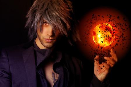 handsome Wizard with a fireball Standard-Bild