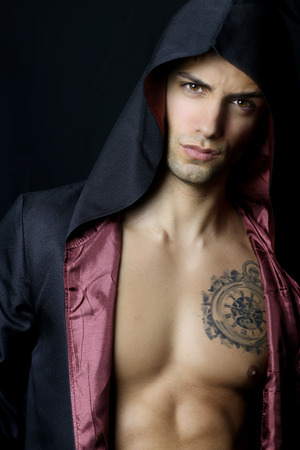 male model torso: Handsome muscular man with a black hood