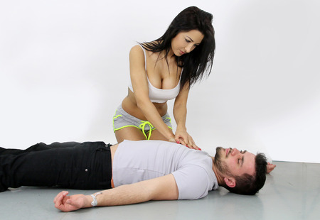 compressions: Sexy cardiac massage Stock Photo