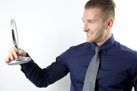 man s: handsome man \ s admire in the mirror Stock Photo