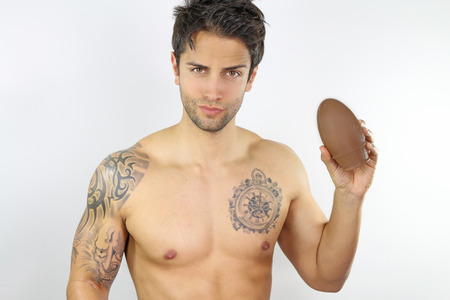 chocolate eggs: Handsome man showing easter egg Stock Photo