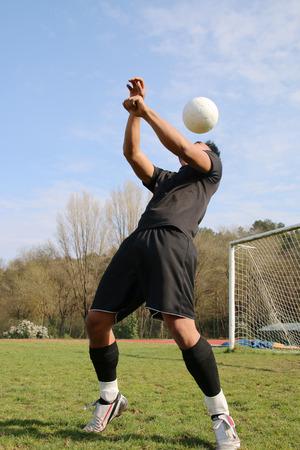 juggle: football player juggling