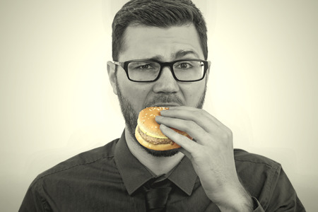 man eating a hamburger Stock Photo