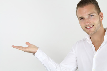 adultery: businessman holding his hand on a white background