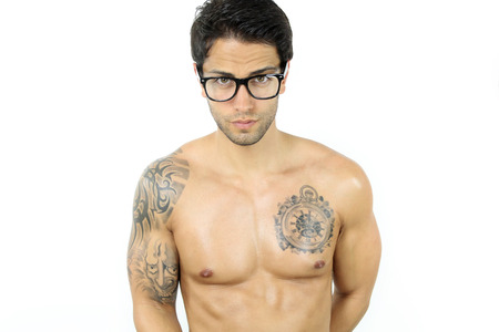 shirtless young man with glasses