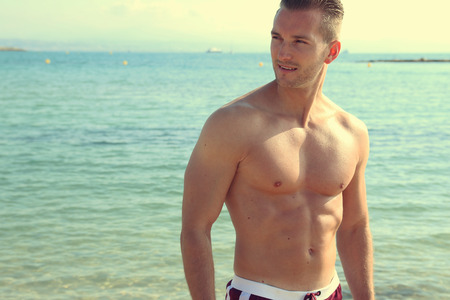 male model torso: handsome man by the sea