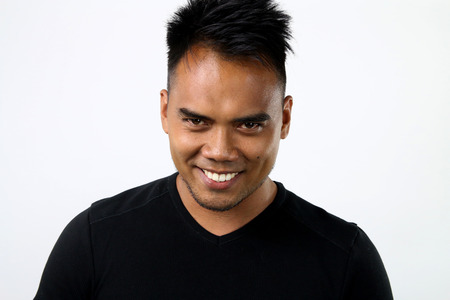 asian man with a devilish look Stock Photo