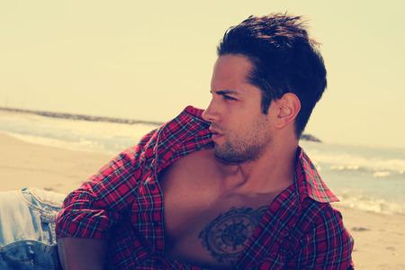 italian man: sexy male on the beach