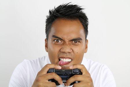 jugando videojuegos: asian boy jugar videojuegos Foto de archivo