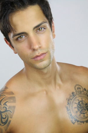 sexy tattoo: portrait of a handsome guy Stock Photo