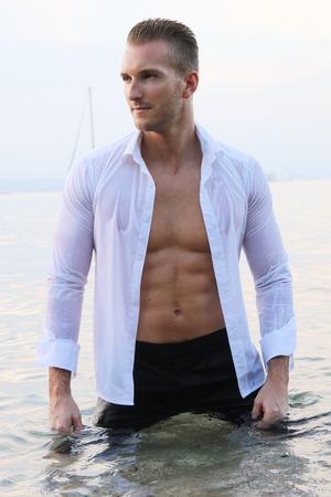 male model torso: Sexy male wet