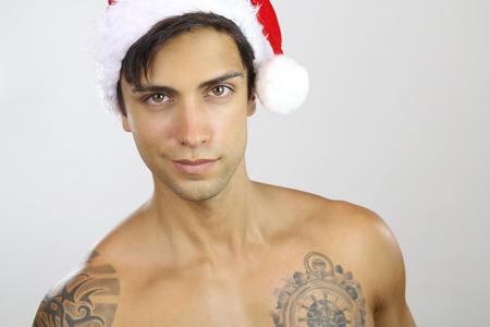 christmas tattoo: Sexy santa claus Stock Photo